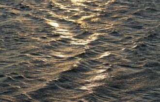 rippling sea water at sundown